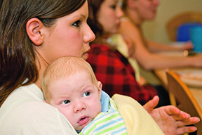 http://www.dreamstime.com/royalty-free-stock-photography-young-mother-newborn-boy-image9008797